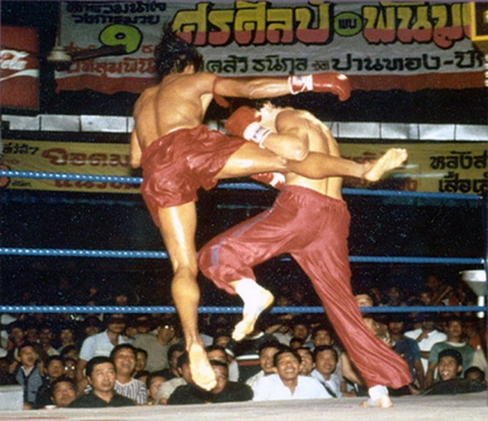 "WKA champion Don ""The Dragon"" Wilson contends with Lumpinee champion Samart Prasanmitr in their disgracefully administered 1983 muaythai bout in Bangkok, Thailand."