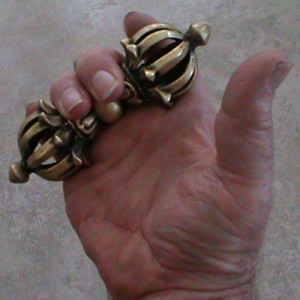 """Preparing to seize a nerve center or locking a finger... With training, the fingers can be """"rolled"""" to create a surprisingly strong grip with the tips of the fingers. Note the muscular development of the hand itself. The vajra promotes surprising hand and forearm strength for seizing joints and pressure points."""